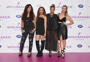 Perrie Edwards paraded her cleavage and abs in a low-cut black crop-top during the launch of Little Mix's new fragrance.