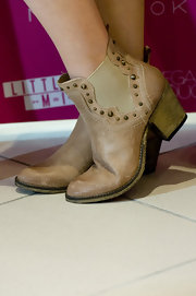 Perrie Edwards rocked a pair of ankle cowboy booties with cool Western studs and distressed leather.