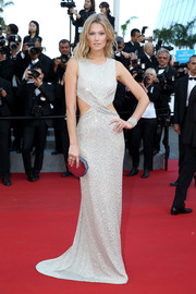 Toni Garrn was trendy and chic in a sparkly silver cutout gown during the Cannes premiere of 'The Little Prince.'