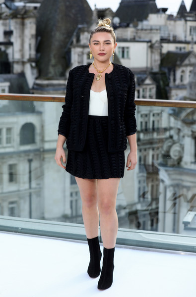 Florence Pugh suited up in a textured black jacket and mini skirt combo by Marco de Vincenzo for the 'Little Women' photocall in London.