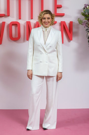 Greta Gerwig kept it simple yet smart in a white double-breasted pantsuit at the 'Little Women' evening photocall in London.
