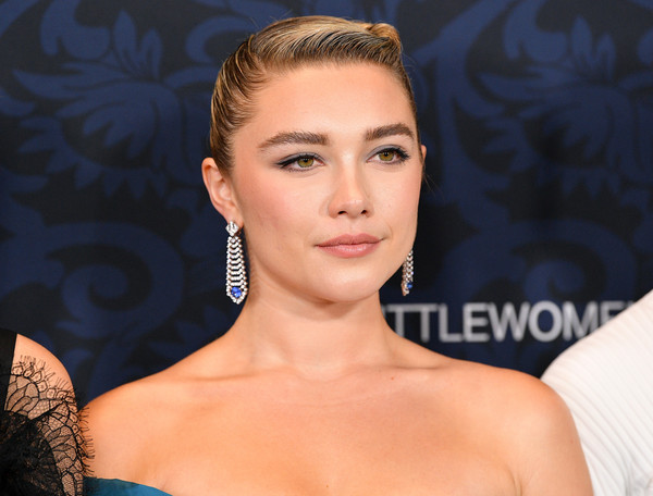 Florence Pugh's dazzling chandelier earrings provided an ultra-glam finish.