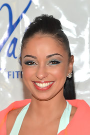Mya swept bright teal shadow over her lids and under her lower lash line for the 2013 Inaugural Dance Party.