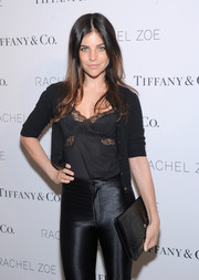 Julia Restoin-Roitfeld attended the 'Living in Style' book launch carrying a stylish black crocodile clutch.