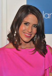Soleil Moon Frye matched her flirty fuchsia lipstick to her bright ultra-feminine frock.