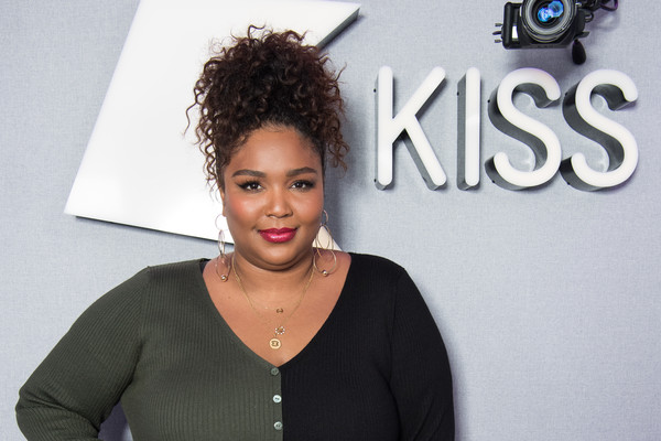Lizzo Curly Updo [hair,hairstyle,beauty,forehead,black hair,makeover,long hair,lace wig,ringlet,fawn,lizzo,kiss fm,london,england]