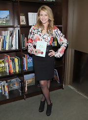 Lauren wore a colorful print blouse when promoting her book 'The Lo' Down.'