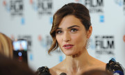 Rachel Weisz attended the Dare Gala wearing a glamorous bun with a wavy tendril down one side.