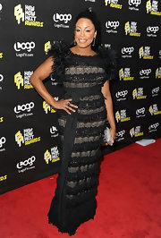 Niecy was avant-garde at the NewNowNext Awards in an opulent black evening dress with rich texture and a tie belt.