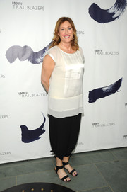 Judy Gold kept it relaxed in a loose white blouse at the Logo TV Trailblazers event.