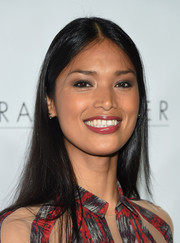 Geena Rocero attended the Trailblazer Honors wearing her long tresses unstyled.