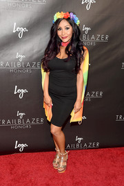 Nicole Polizzi sported a pair of metallic platform sandals for added height.