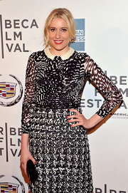 Greta Gerwig matched her cheerful red fingertips to her shiny ruby lips.