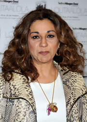 "While promoting her new show ""De lolita a lola"", Lolita showed off her natural curls."
