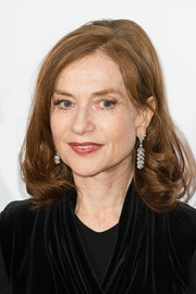 Isabelle Huppert sported a teased crown and curly ends when she attended the London Critics' Circle Film Awards.