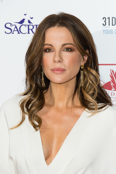 Kate Beckinsale's hair flowed past her shoulders in ultra-feminine waves when she attended the London Critics' Circle Film Awards.