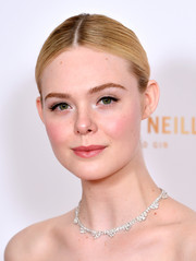 Elle Fanning opted for a center-parted updo when she attended the 2020 London Critics' Circle Film Awards.