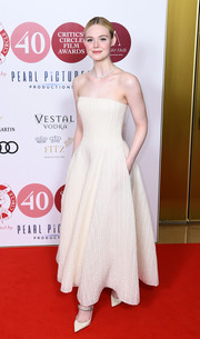 Elle Fanning kept it minimal yet elegant in a strapless cream gown by Ralph Lauren at the 2020 London Critics' Circle Film Awards.