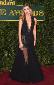 Annabelle Wallis was a goth princess in a partially sheer, lace-trimmed black gown by Stella McCartney at the London Evening Standard Theatre Awards.