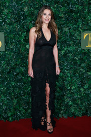 Elizabeth Hurley looked ravishing in a semi-sheer black gown with a plunging neckline and a high front slit at the London Evening Standard Theatre Awards.