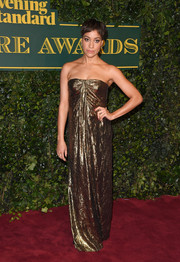 Cush Jumbo shimmered in a strapless gold gown by Michael Kors at the London Evening Standard Theatre Awards.