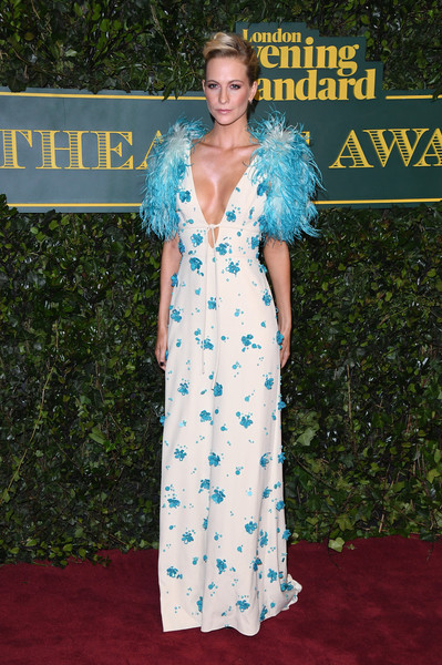 Poppy Delevingne was a vision in a plunging white Prada gown with blue floral embroidery and feathered sleeves at the London Evening Standard Theatre Awards.