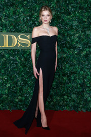 Lily Donaldson made a head-turning entrance in a high-slit black off-the-shoulder gown by Burberry at the London Evening Standard Theatre Awards.