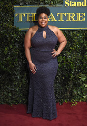 Amber Riley cut a shapely silhouette in a body-con halter gown with a keyhole cutout at the London Evening Standard Theatre Awards.