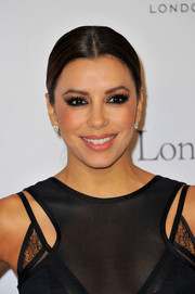 Eva Longoria exuded classic elegance with her center-parted ponytail at the London Global Gift Gala.