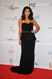 Vanessa White was classic in a strapless black peplum gown during the London Global Gift Gala.