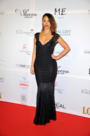 Amelle Berrabah showed off some fierce curves in a black bandage-panel mermaid gown during the London Global Gift Gala.