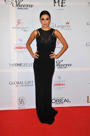 Eva Longoria smoldered in a black sheer-panel evening dress by Victoria Beckham during the London Global Gift Gala.