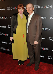 Bryce Dallas Howard wore a chiffon chartreuse evening dress with orange tassels for the 'When You Find Me' red carpet.
