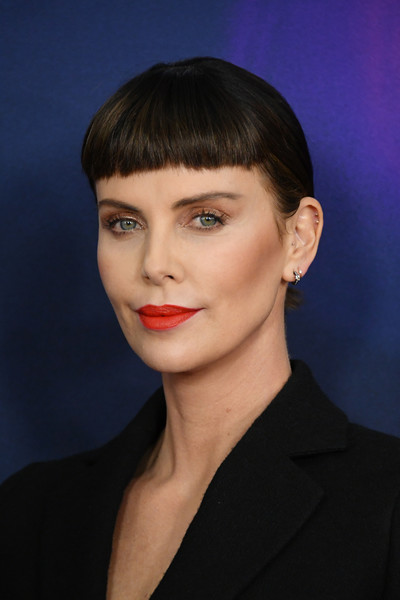 Charlize Theron debuted her new bangs at the premiere of 'Long Shot.' The back was gathered into a simple ponytail, which ensured the blunt bangs really stood out.
