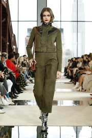 Kaia Gerber was moto-chic in a cropped military-green suede jacket while walking the Longchamp Fall 2020 runway.