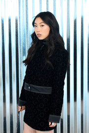 Awkwafina accessorized with a silver statement ring for a hint of sparkle to her black outfit at the Longchamp Spring 2019 show.