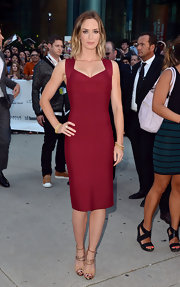 Emily Blunt showed off her killer curves in this deep cranberry dress.