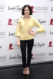 Lucy Hale was a cutie in a yellow Designers Remix sweater with fluted sleeves at the Charity Days: Let's Do Something Good Together event.