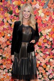 Christie Brinkley looked festive in a pleated gold and silver cocktail dress at the Lord & Taylor Garden City grand reopening.