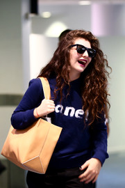 Lorde hid her eyes behind a pair of wayfarers while making her way through the airport.