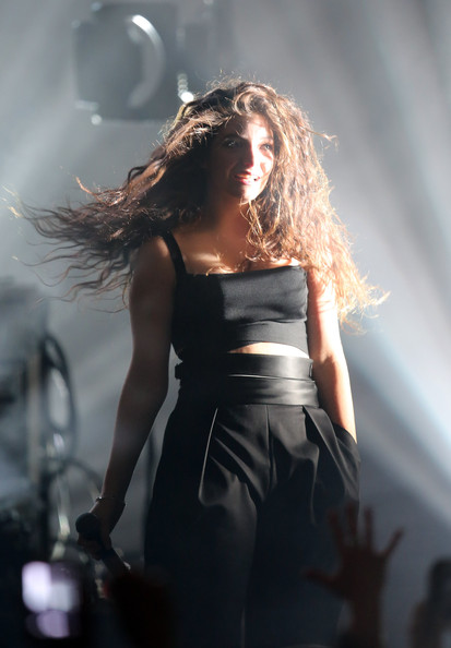 Lorde teamed a black crop-top with matching trousers for her performance at Dunedin Town Hall.