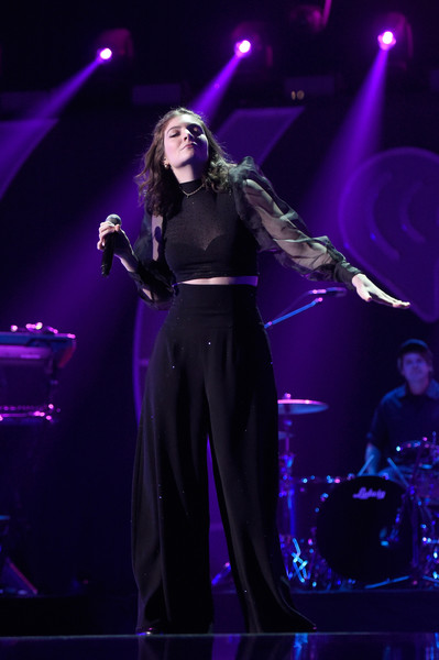 Lorde Crop Top [night 2 - show,performance,entertainment,performing arts,music artist,concert,music,musician,stage,event,purple,lorde,las vegas,nevada,t-mobile arena,iheartradio music festival]