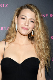 Blake Lively gave us '80s vibes with this teased hairstyle at the launch of the Eye Bangle.