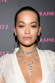 Rita Ora complemented her low-cut dress with a layered gemstone necklace by Lorraine Schwartz.