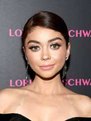 Sarah Hyland opted for a slick side-parted updo when she attended the launch of the Eye Bangle.