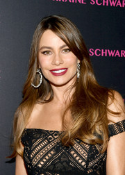 Sofia Vergara wore her long hair down with a shallow side part at the launch of the Eye Bangle.