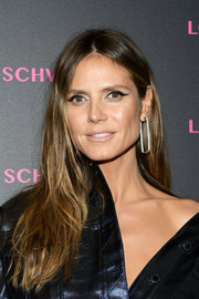 Heidi Klum worked a thick cat eye while keeping the rest of her beauty look low-key.