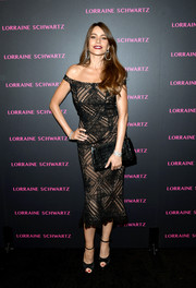 Sofia Vergara was svelte and sophisticated in a lacy black off-the-shoulder dress by Martha Medeiros at the launch of the Eye Bangle.