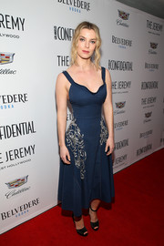 Betty Gilpin cut a shapely figure in a navy fit-and-flare dress with silver beading at the Los Angeles Confidential awards issue celebration.