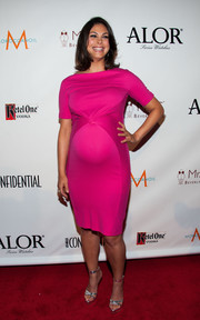 Morena Baccarin showed off her bright maternity style with this simple yet stylish fuchsia dress during the LA Confidential pre-Emmy celebration.